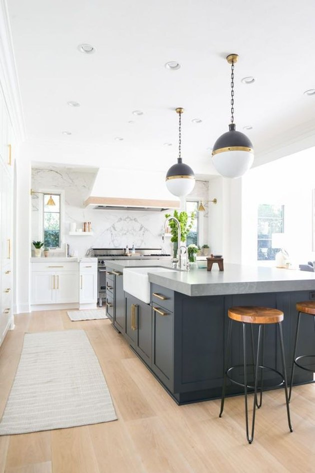 dark kitchen island with concrete countertop