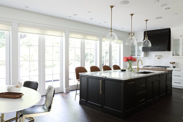black kitchen island with marble top