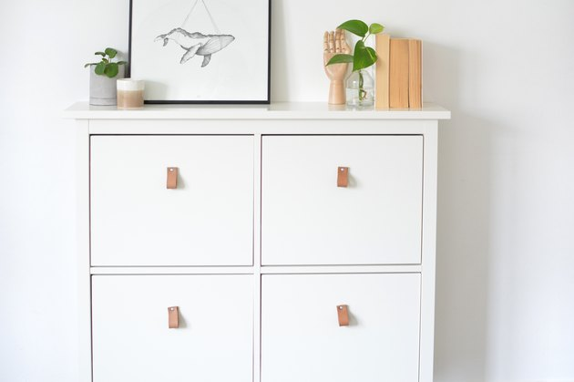 White cabinet with four doors and leather pulls