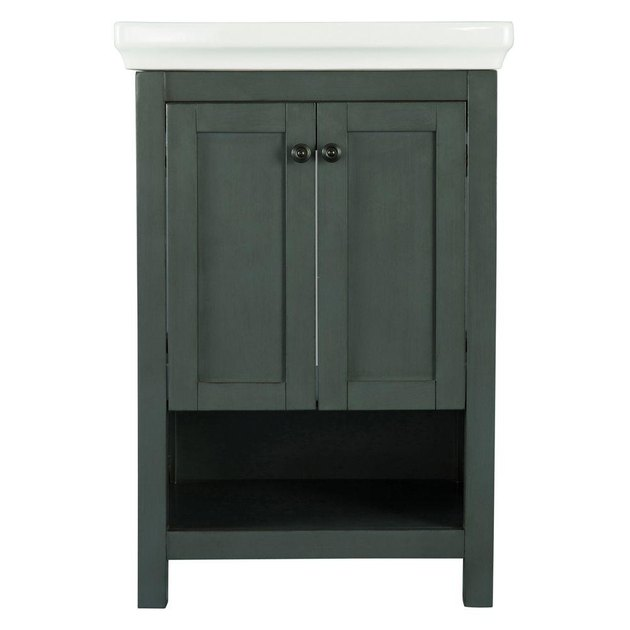 Green small bathroom vanity with double door cabinet, sink, and cubby