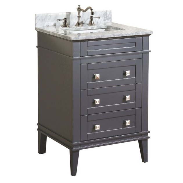 Gray painted small bathroom vanity with geometric knobs and marble countertop