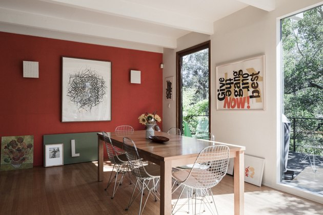 red dining room color idea with floor to ceiling windows and wood table