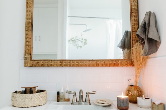 bathroom sink with wood frame mirror
