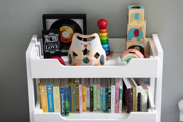 nursery shelf with toys and books