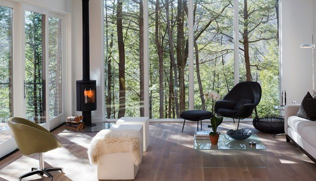 contemporary living room with big windows and wood stove fireplace