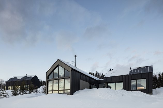 Scandinavian style house with large windows in snowy landscape