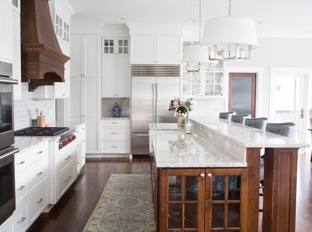 two tier kitchen island with white granite countertop and wood base