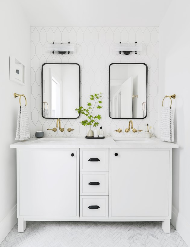 White Bathroom Cabinet with black hardware and double sinks by Emily Henderson Design