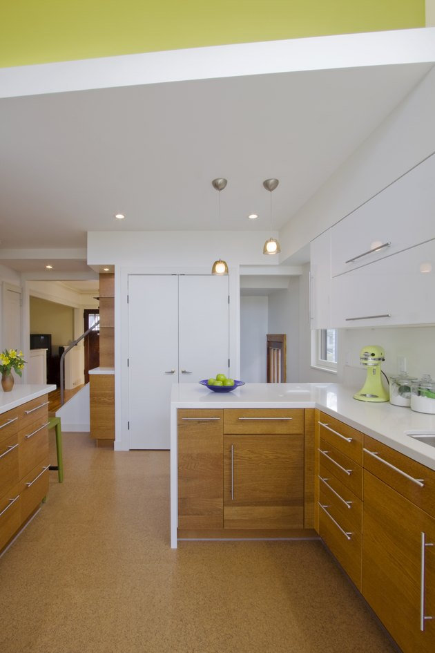 kitchen space with wood cabinets and cork flooring