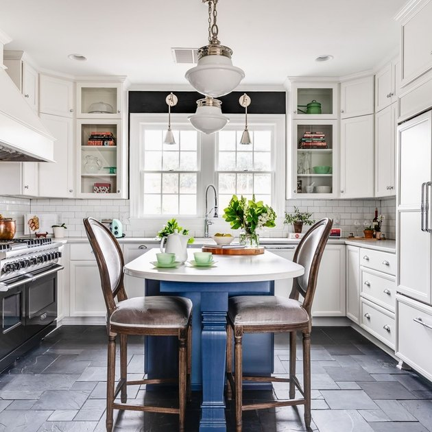 Black kitchen floor featuring slate in various sizes