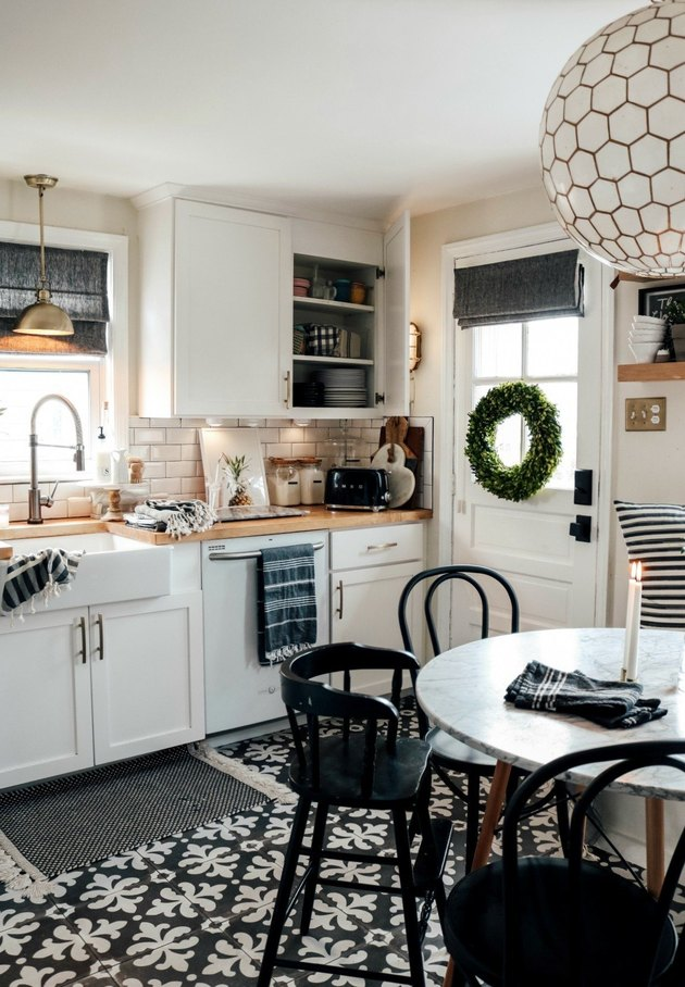 Black kitchen floor in black and white tile and farmhouse details