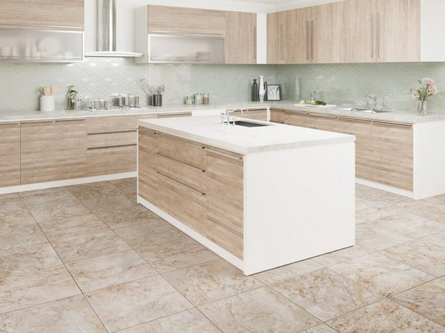 kitchen space with light wood cabinets and cream floor
