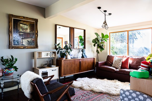 bohemian living room idea with layered rugs and leather seating