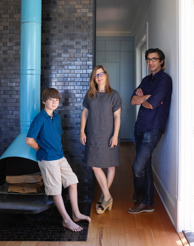 Heath owners with son in their Sausalito home with turquoise firelplace