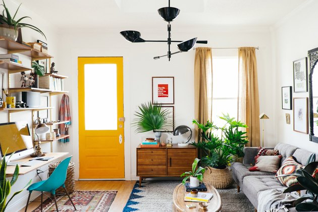 living room with yellow front door