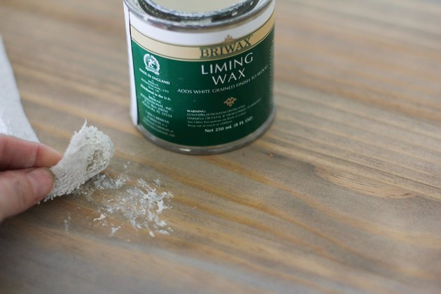 Buffing liming wax onto table
