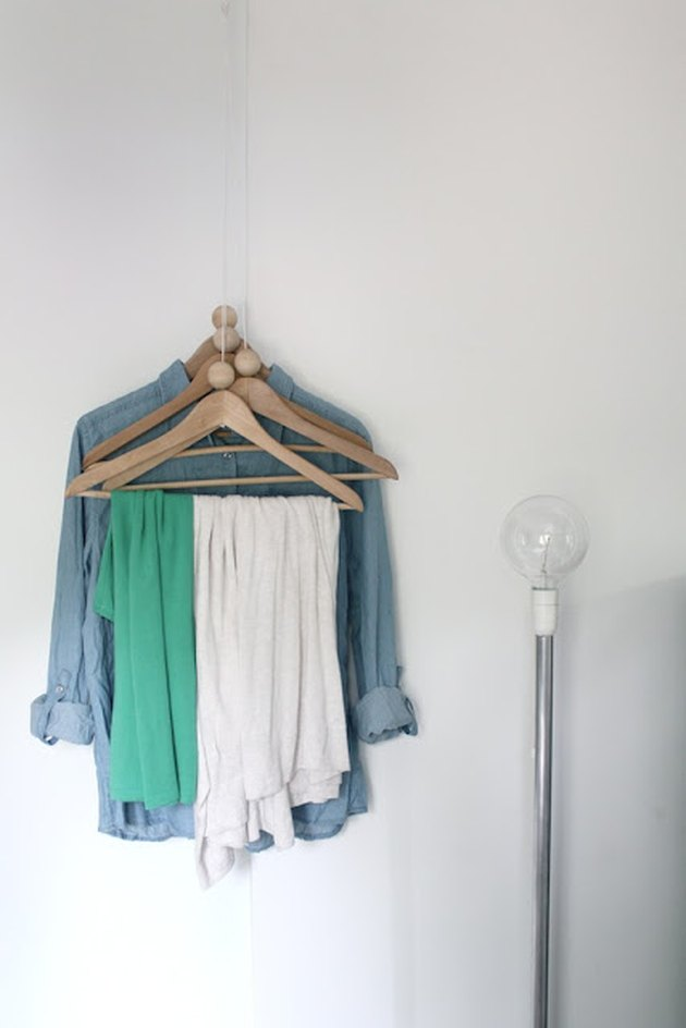 DIY coat hangers that hang from the ceiling for small space
