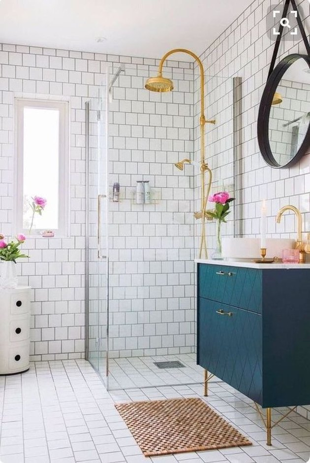 harlequin pattern blue bathroom cabinets with white countertop and vessel sink