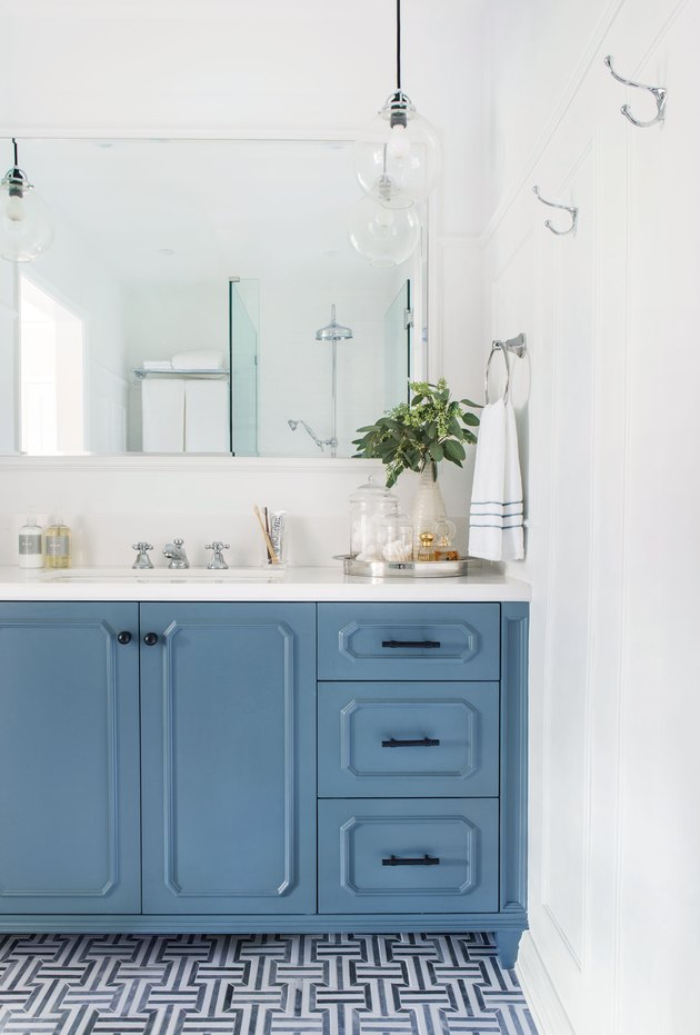 pigeon blue bathroom cabinets in coastal bathroom with white countertop and patterned tile