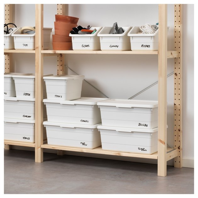 white boxes on a wood shelf