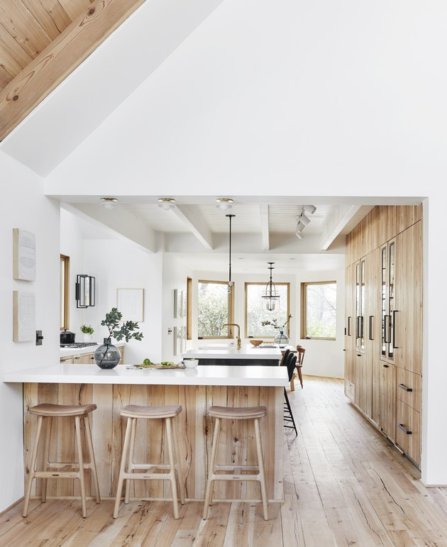 Kitchen island back panel idea with wood to match the floor by Emily Henderson