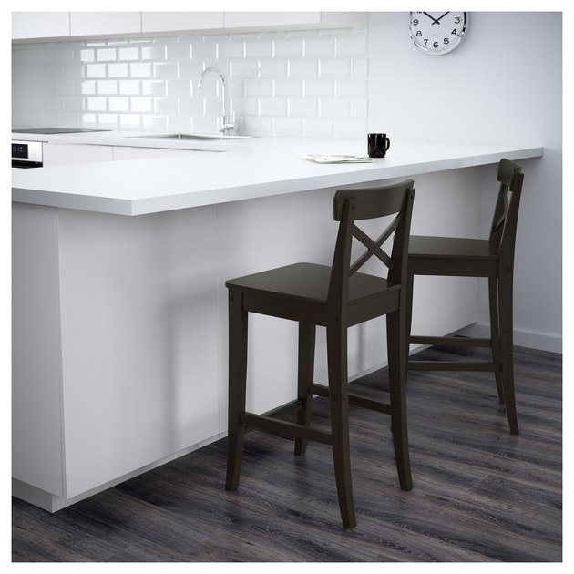 dark brown bar stools in white kitchen