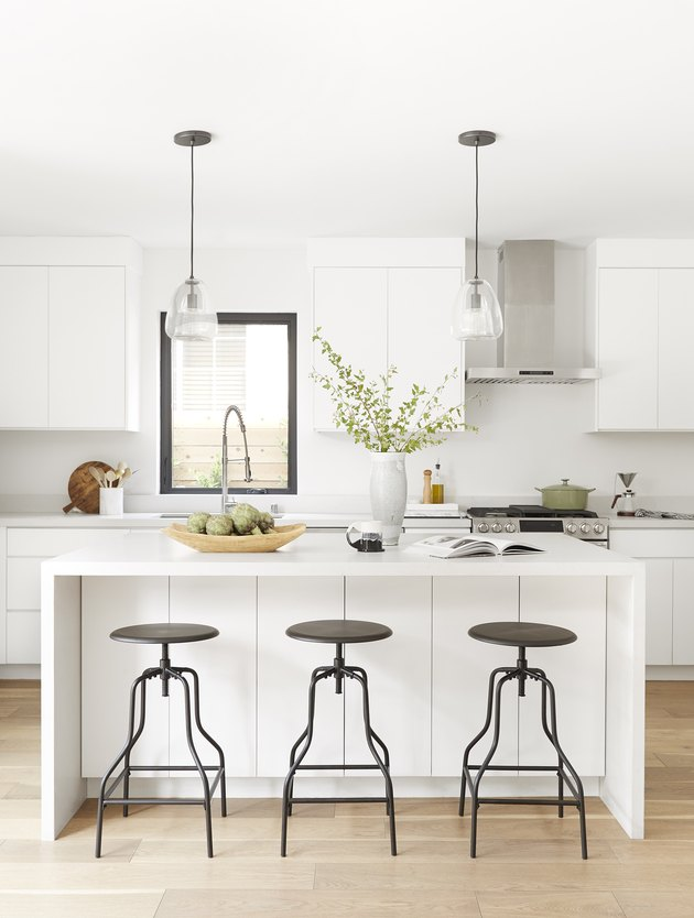Industrial bar stools from Target in a white kitchen