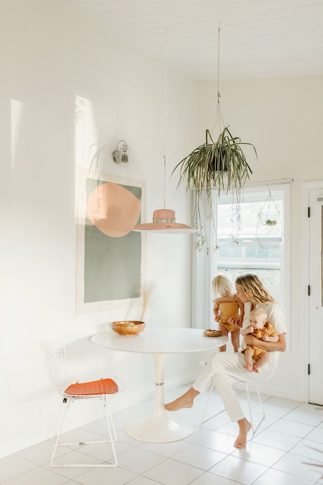 White kitchen with hanging plant and artwork