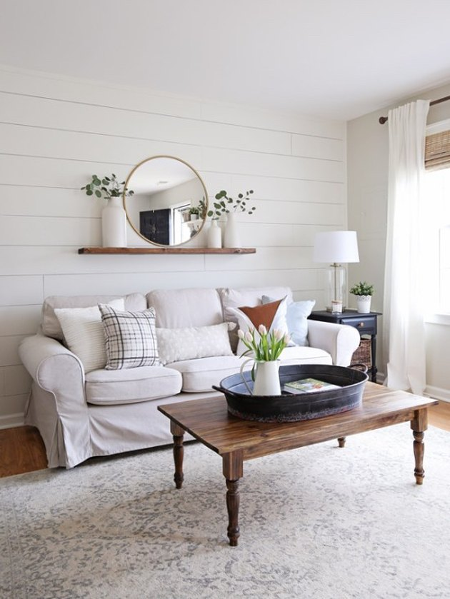 Farmhouse living room with shiplap wall and Target table lamp