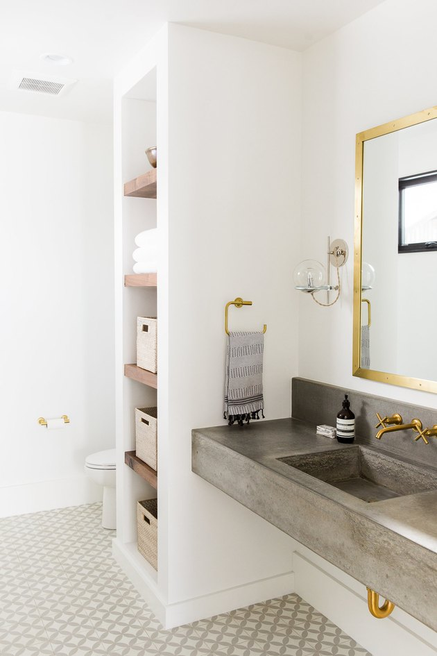 concrete industrial bathroom vanity and brushed gold accents