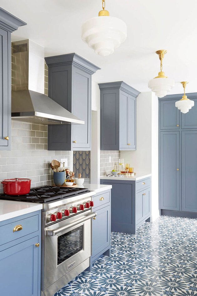 blue kitchen floor with patterned tile and blue cabinets