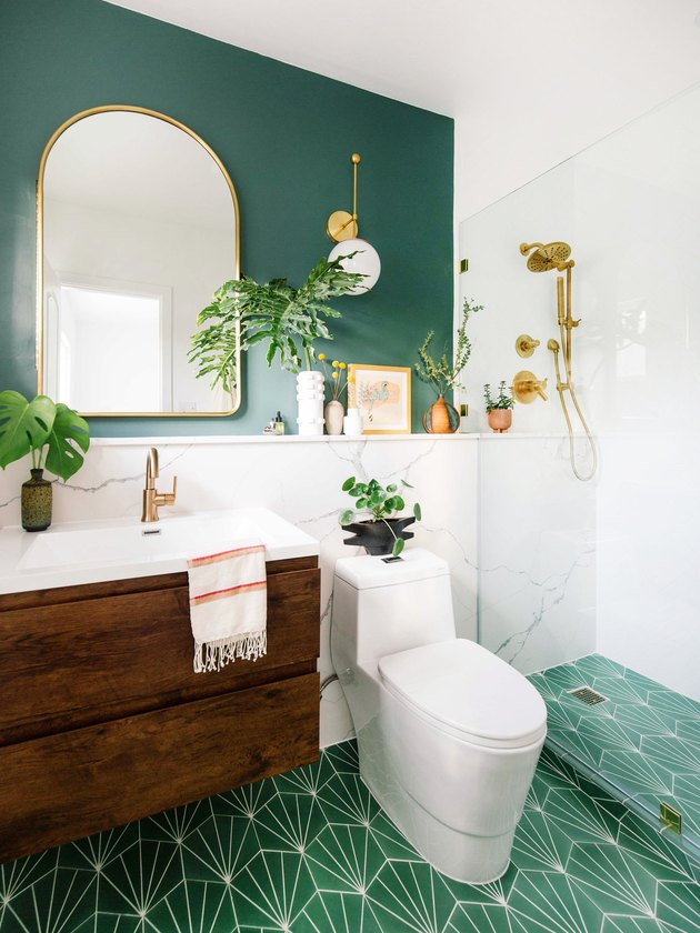 emerald green bathroom with walnut and gold bathroom fittings