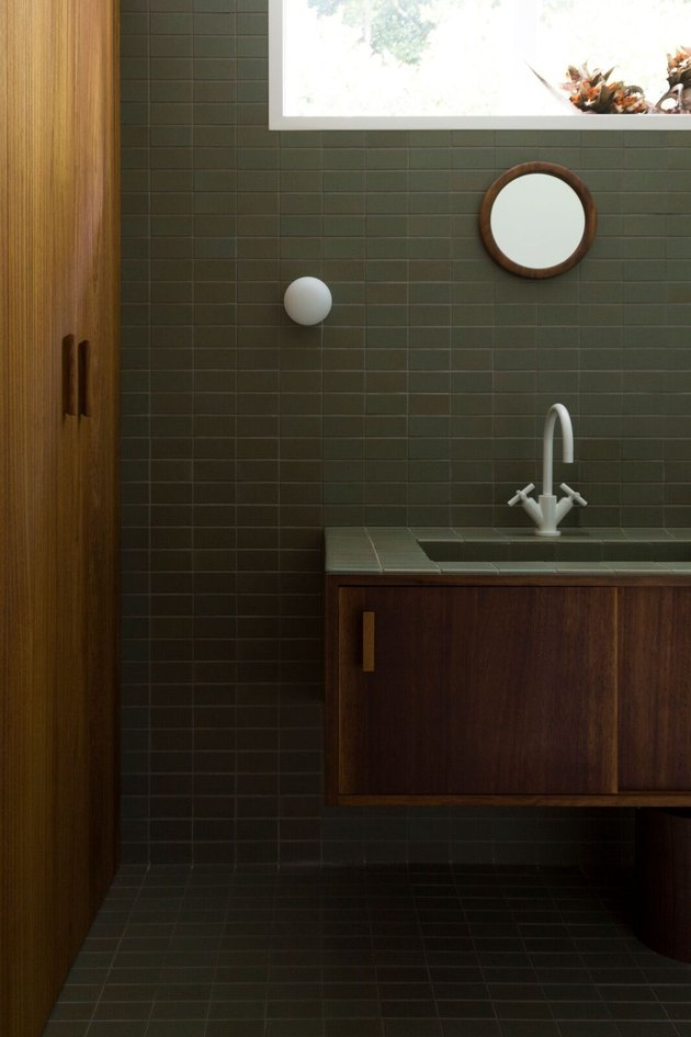 green bathroom idea with ceramic wall and floor tile