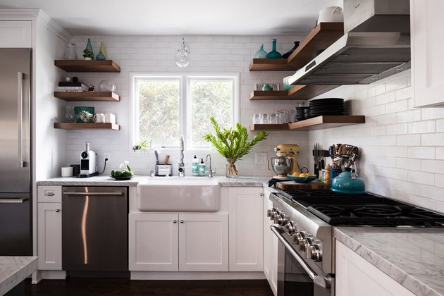 kitchen with stainless steel appliances, white cabinetry, subway tile backsplash, exposed upper shelving