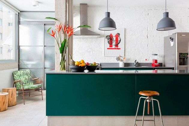teal kitchen island with industrial lighting