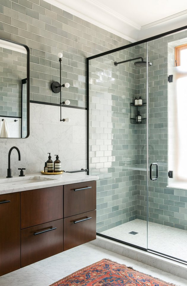 green bathroom idea with glass shower enclosure