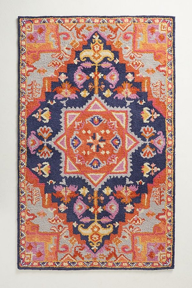Vibrant orange, pink, and navy blue variegated area rug