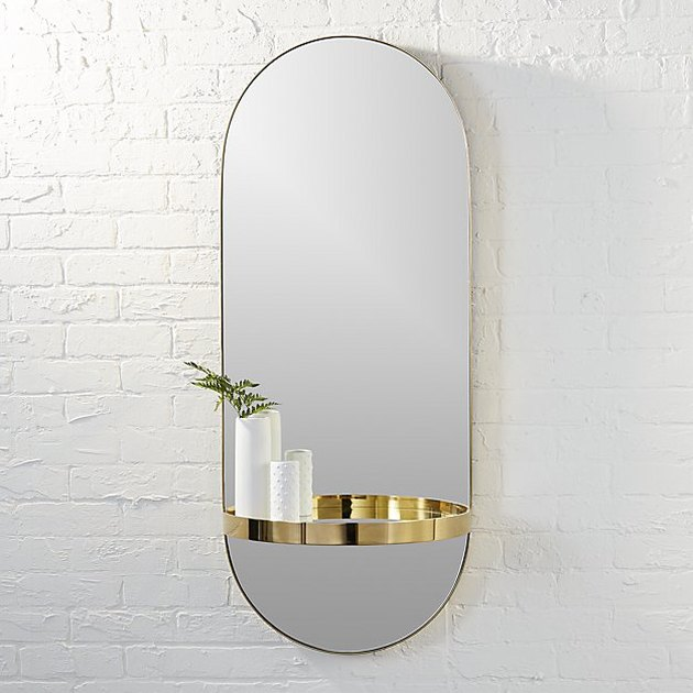 oval wall mirror with shelf