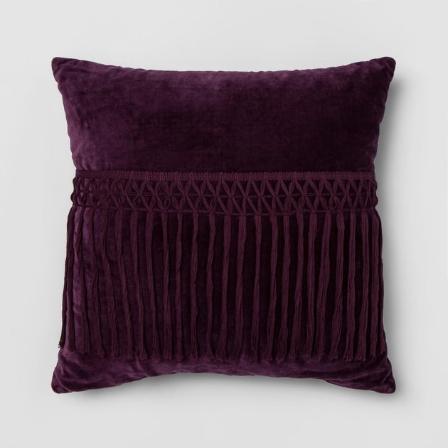 velvet accent pillow with fringe detail