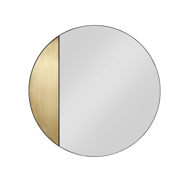 round mirror with gold accent