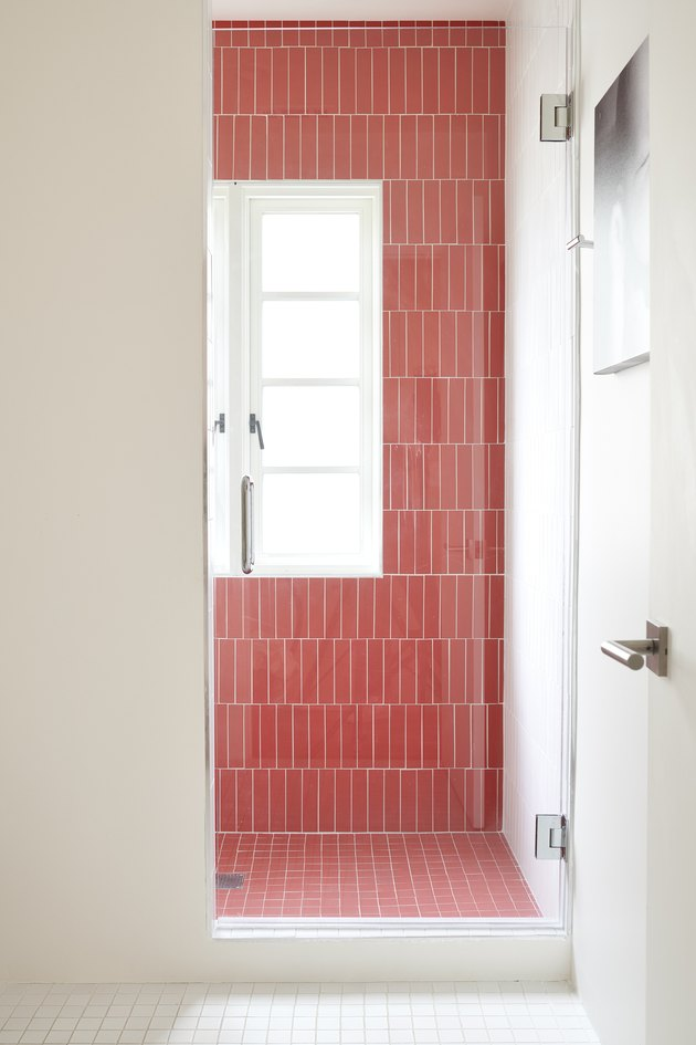 bathroom with red tile shower