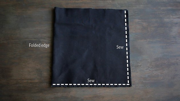 Canvas fabric folded in half with guidelines marked for sewing