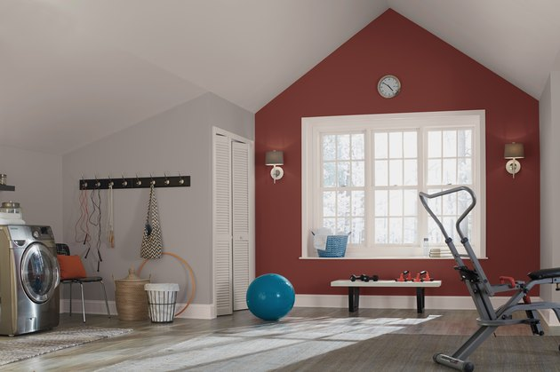 exercise area with deep red accent wall