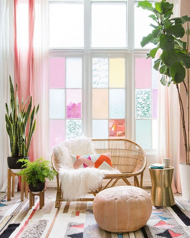 living room with pink drapery panels and pink stained glass windows