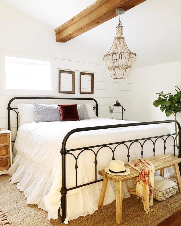 rustic bedroom lighting idea with beaded chandelier with black metal bed in rustic bedroom