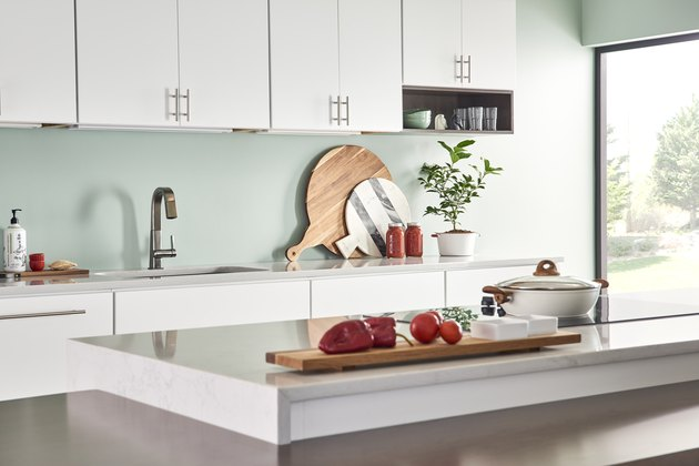 kitchen area with light blue green backsplash