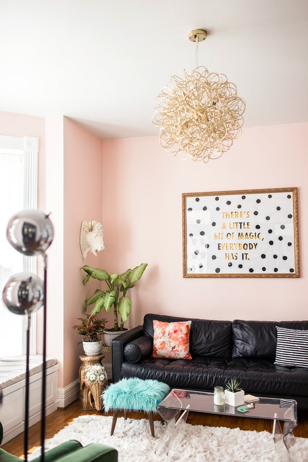 pink living room with black accents