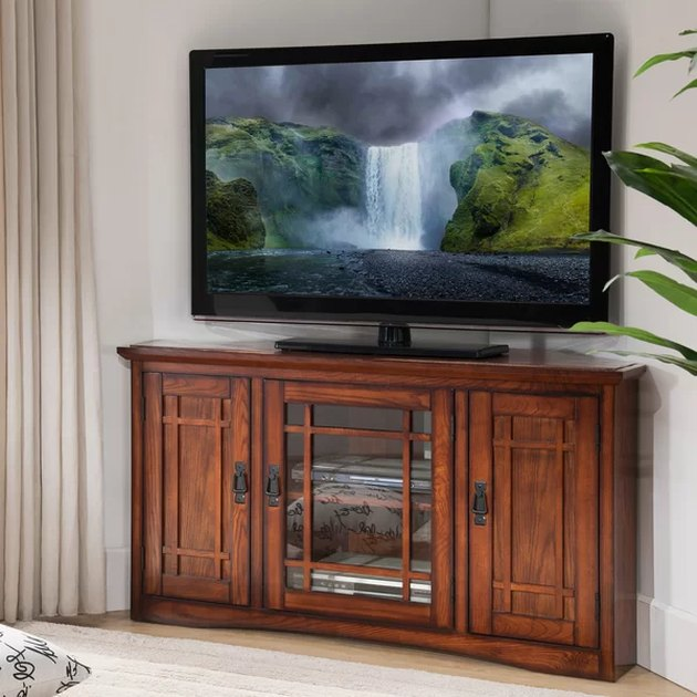 Wooden corner TV unit with glass window