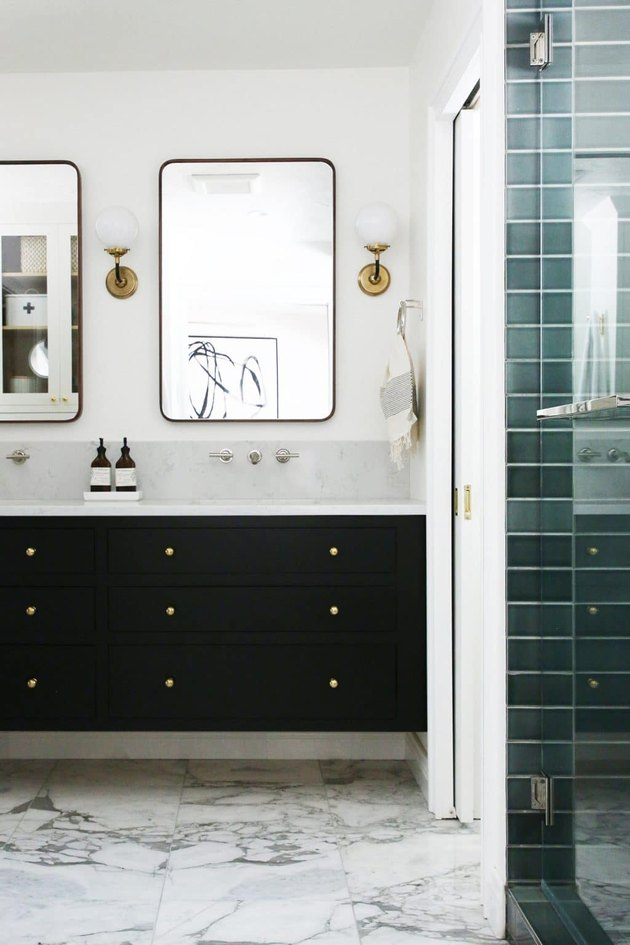 aqua ceramic tile on shower wall in bathroom