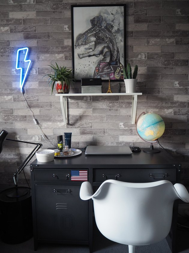 teen boy bedroom with neon sign
